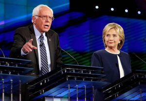 Credit: https://usatcollege.files.wordpress.com/2015/10/democratic-debate.jpg Trouvé sur : https://www.theodysseyonline.com/clinton-sanders-debate-held-flint-michigan-march-6